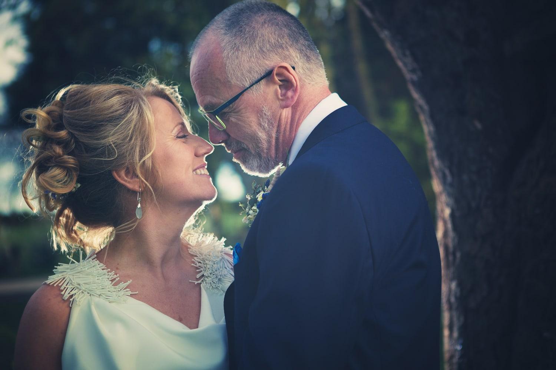 Newton Hall, back lit bride and groom