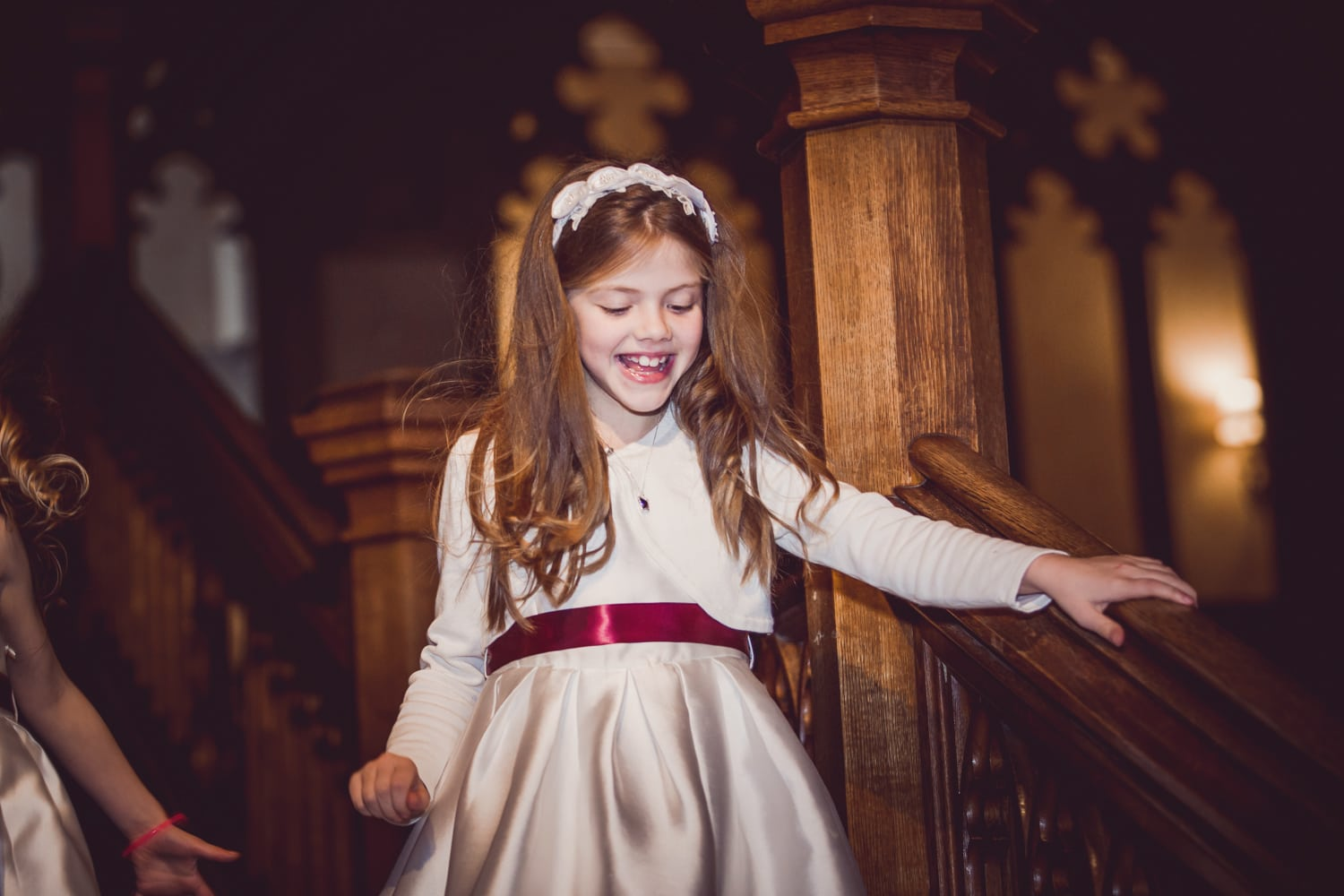 Matfen Hall, happy child on stair case