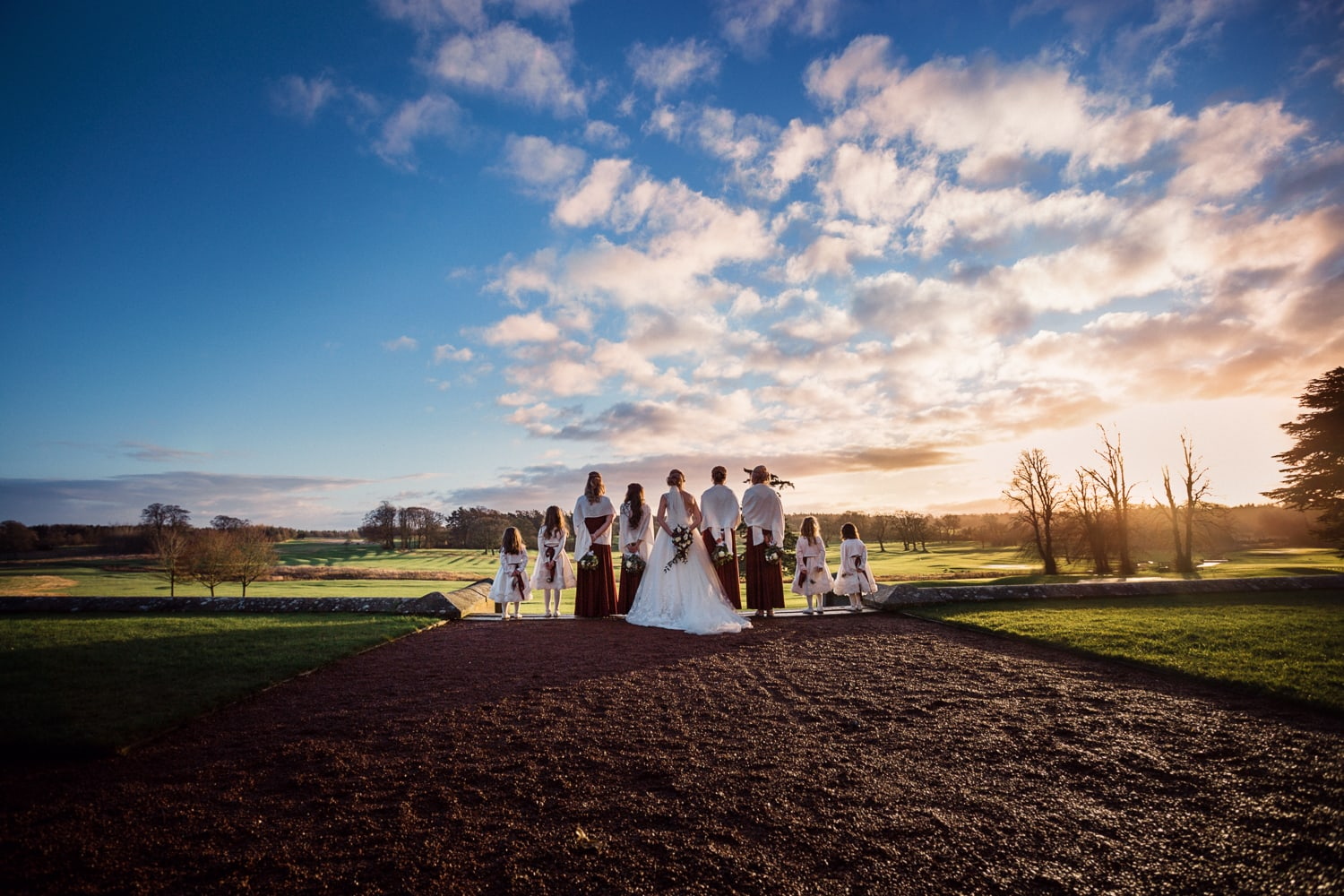 Matfen Hall, stunning sky with bridesmaids