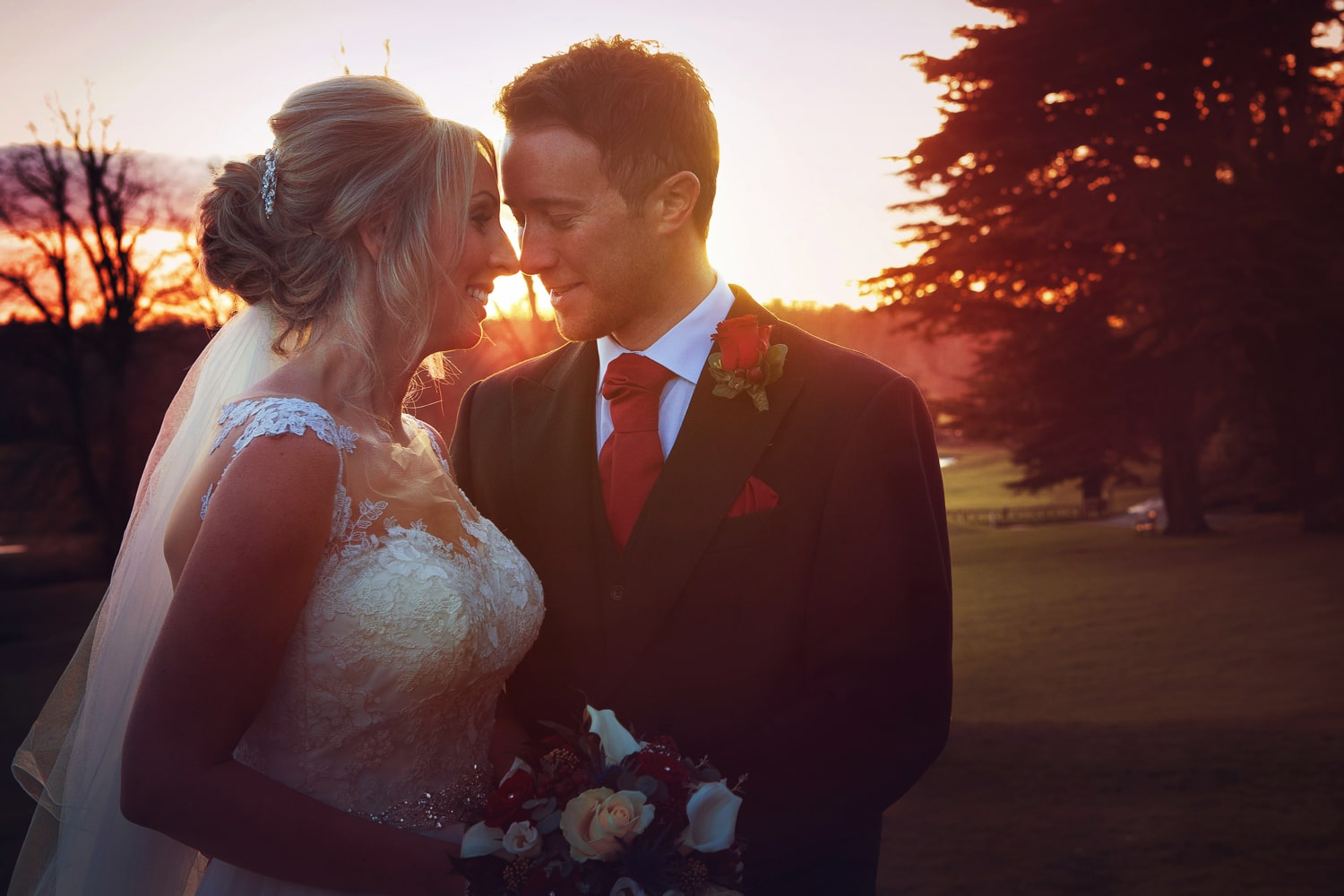 Matfen Hall, sunset, orange with bride and groom
