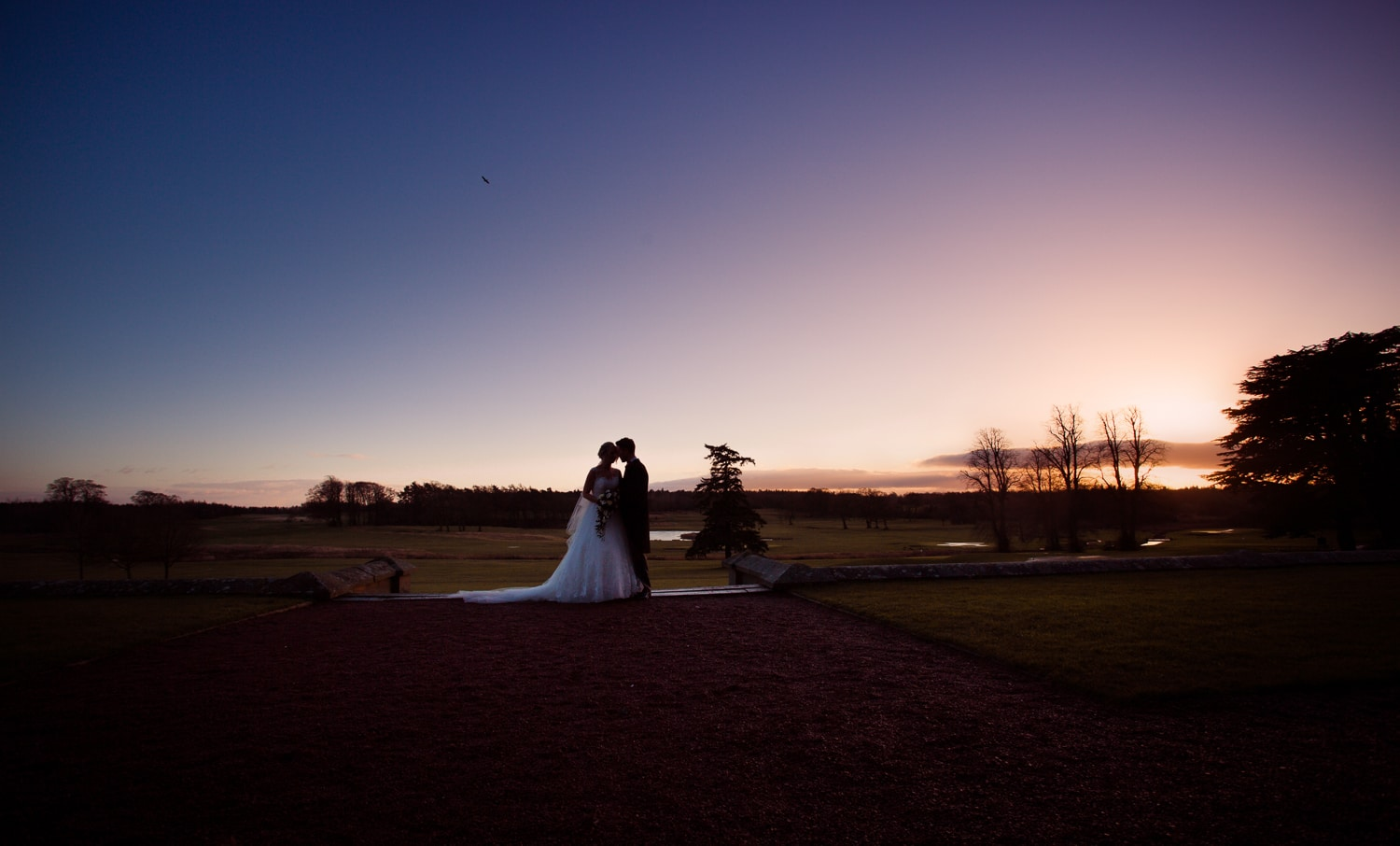 Matfen Hall, sunset bride and groom