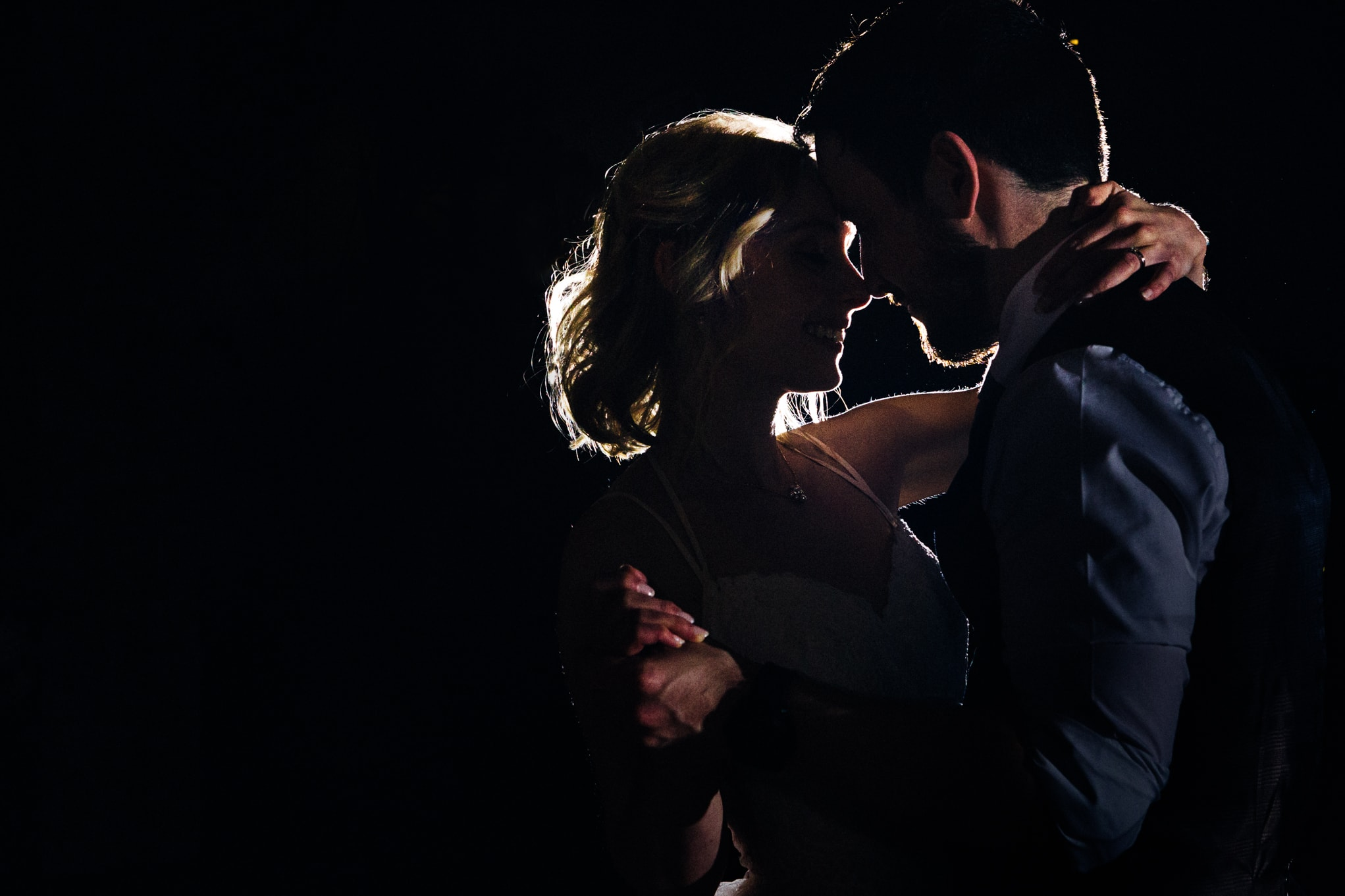 Le Petit Chateau, back lit couple dancing
